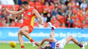 Tom Rockliff of the Lions is knocked out after colliding with Steven May.