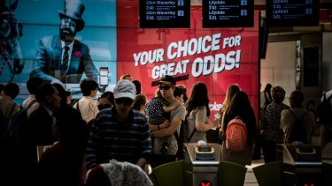 Gambling advertising at Melbourne's Flinders Street Station.
