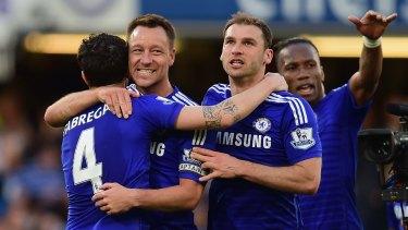 Passports at the ready: Chelsea stars Cesc Fabregas, John Terry, Branislav Ivanovic and Didier Drogba.