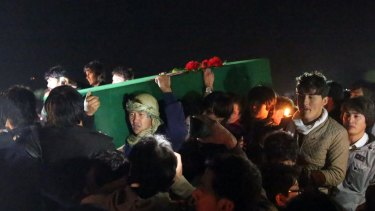 Hazara tribesmen carry the coffin of a beheaded Hazara victim in Kabul on Tuesday.