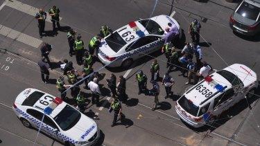 Police lock down Bourke Street Mall last Friday.