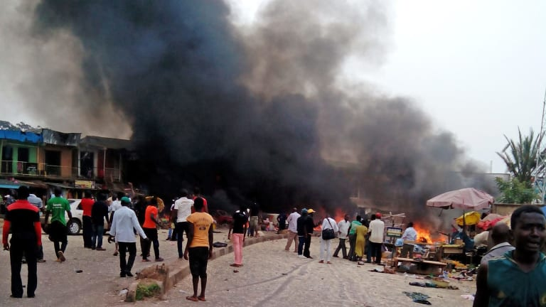 Smoke rises after a bomb blast at a bus terminal in Jos, Nigeria on May 20, 2014. Boko Haram is again being blamed for the latest bombing attack in Chibok.