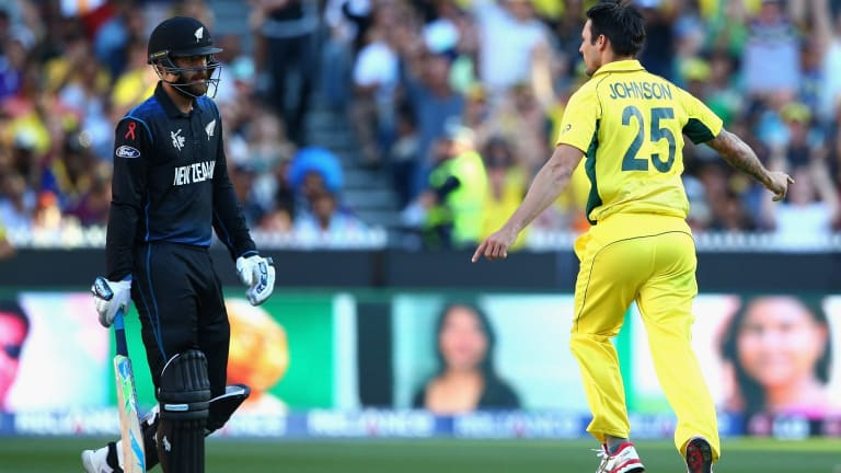 Daniel Vettori is dismissed by Mitchell Johnson and sent on his way with a few words.