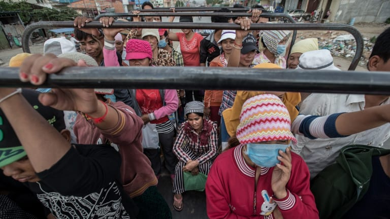 Around 700,000 Cambodians, mostly women, work in  garment factories. Thousands of the workers cram together on trucks from the provinces to  work in factories on the outskirts of Phnom Penh.