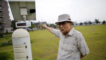 Atsushi Hoshino, a 87-year-old Hiroshima atomic bombing survivor, former college professor and ex-president of Fukushima University, beside a radiation meter, near his home in Fukushima.