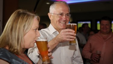Prime Minister Malcolm Turnbull drinks beer with former Liberal MP Natasha Griggs in Darwin.