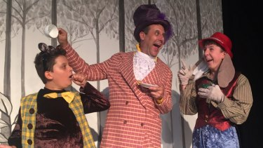 William Best (left) as the Dormouse, Jim Adamik as the Mad Hatter, and Oliver Johnstone as the March Hare in Ickle Pickle's <i>Alice in Wonderland</I>.
