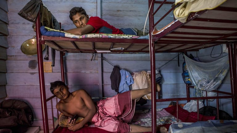 Rohingya refugees inside their temporary shelter in Aceh, Indonesia, in October.