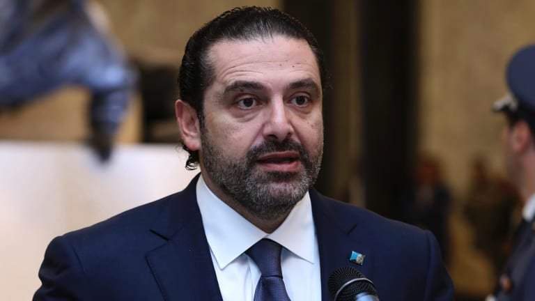 Lebanese Prime Minister Saad Harri reads a statement after his meeting with Lebanese President Michel Aoun.