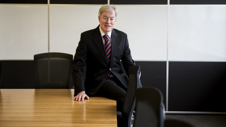 Public service commissioner John Lloyd has faced questions about his links to the Institute of Public Affairs.