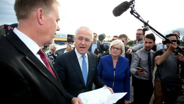 Prime Minister Malcolm Turnbull speaks with Liberal Member for Forde Bert Van Manen and Liberal Member for McPherson Karen Andrews as a political bunfight began over Pacific Highway funding in July 2016.