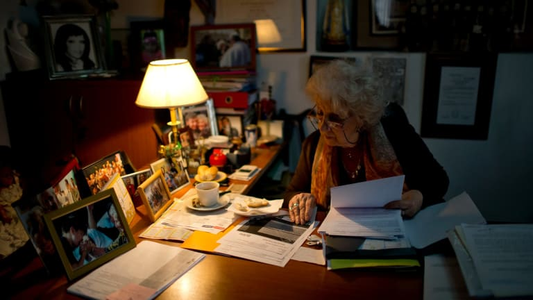 Estela de Carlotto, head of the human rights group Grandmothers of the Plaza de Mayo, works at her desk in Buenos Aires.