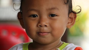A child in Khmounh, where there are a large number of children in keeping with Cambodia's high national birth rate.