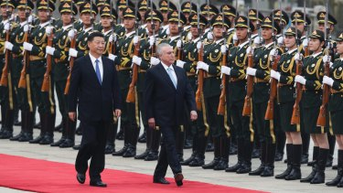 Chinese President Xi Jinping with Brazil's President Michel Temer, right, in Beijing on Friday.