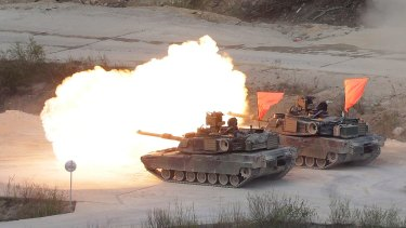 Two US Army M1 A2 tanks fire during South Korea-US joint military live-fire drills at Seungjin Fire Training Field in Pocheon, South Korea, near the border with North Korea, on Wednesday.