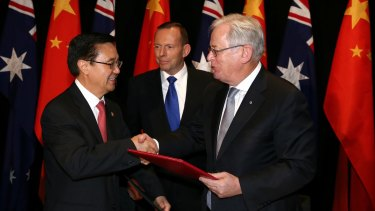 Chinese Commerce Minister Gao Hucheng, former prime minister Tony Abbott and then trade minister Andrew Robb at the signing of the China-Australia free trade agreement in June 2015.