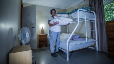 Robyn prepares a room at the refuge, vacated just the day before. In 24 hours, another woman will find sanctuary here.