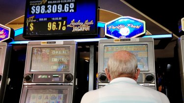 A man plays the pokies at Mounties Club in Mount Pritchard in the City of Fairfield, whose residents wagered nearly $8.5 billion last year.