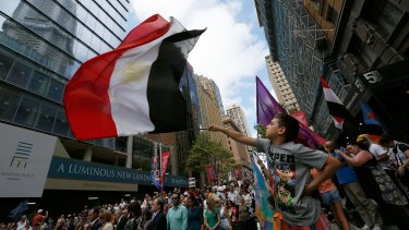 Kyrollos Ayaad, 9, waves an Egyptian flag at a rally organised by the Australian Coptic Movement Association.
