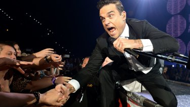 Robbie Williams performs in Brisbane during his 2014 tour.