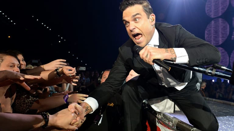 Robbie Williams performs in Brisbane during his 2014 tour.