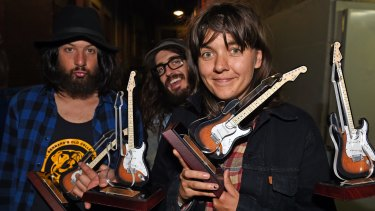 Courtney Barnett and band pose with their 4 awards.