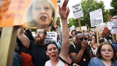 Protesters attend a rally outside Downing Street calling for justice for those affected by the Grenfell Tower fire.