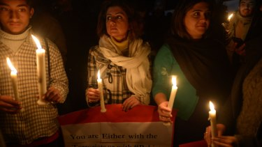 Undeterred: A vigil outside Islamabad's Red Mosque. Its imam has refused to condemn the attack.