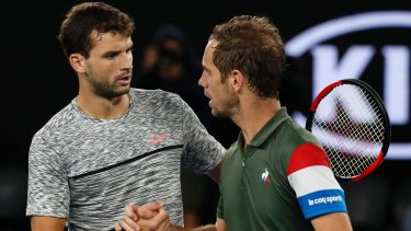 Winner Dimitrov (left) is congratulated by Gasquet