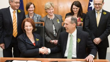 The Greens sign off on a deal in support of the Australian Labor Party in the Prime Minister's Office at Parliament House.