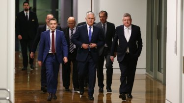 Malcolm Turnbull and supporters arrives for the leadership ballot.