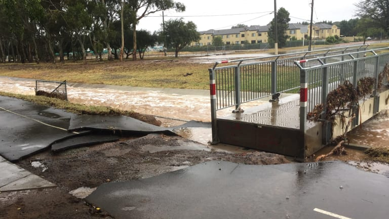 Flooding at Dickson oval on Sunday morning.