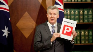"Labor finance spokesman Tony Burke waving a print of a ""P"" plate for Speaker Bronwyn Bishop."