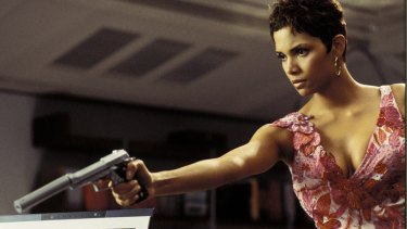 "Actress Halle Berry, is shown in a scene from the new James Bond film ""Live To Die Another Day"" in this undated publicity photograph.  Berry appears in a television special ""Bond Girls Are Forever"" which features actresses who have been featured as Bond girls in James Bond films.  The special will be telecast on the American Movie Classics cable channel November 6, 2002.   NO SALES  REUTERS/AMC/Handout"