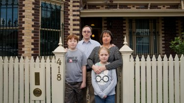 Howard and Gillian Tuxworth, with their children Harry and Molly, at the Collingwood home the Victorian government acquired for the East West Link road tunnel. The family has now relocated.
