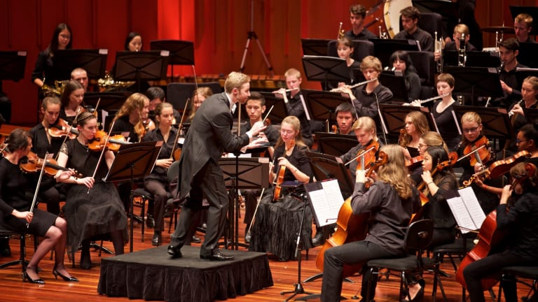Leonard Weiss, centre, conducts the Canberra Youth Orchestra. Photo: William Hall.