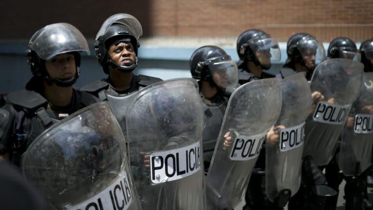 Police block protesters in Caracas, Venezuela.
