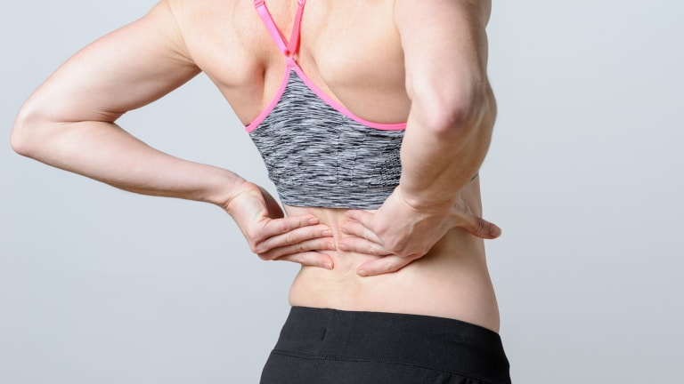 Sore back? Put down the pill and get up and move a little.