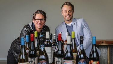 Vinomofo co-founders Andre Eikmeier (L) and Justin Dry pose for a photo at the online wine retailer's headquarters in Melbourne.