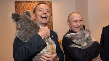 Lasting impression: Prime Minister Tony Abbott and Russian President Vladimir Putin cuddled koalas at the G20 in Brisbane.