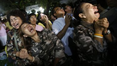 People cry outside Siriraj Hospital after the death was announced.