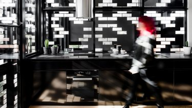 DKO Architecture's lightweight laser-cut screen provides privacy in the upper-level interiors.