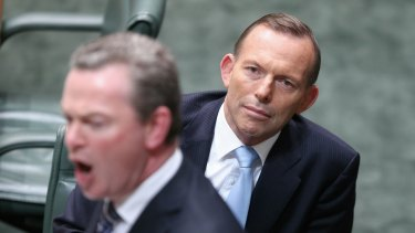 Prime Minister Tony Abbott listens as Leader of the House Christopher Pyne speaks during Question Time.