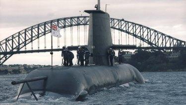 A Collins Class submarine sails through Sydney Harbour.