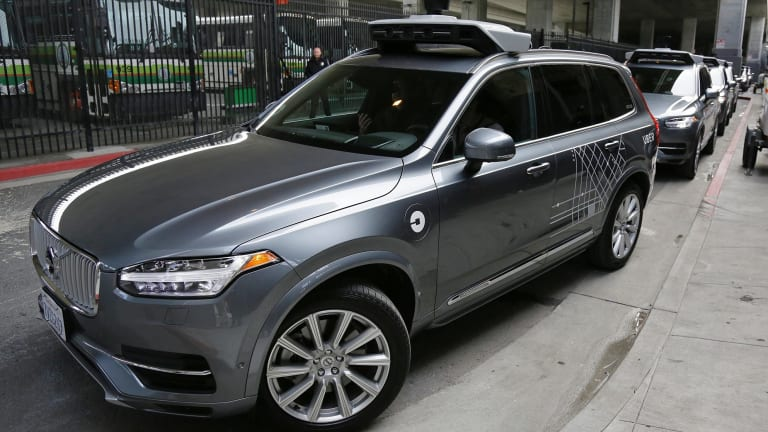An Uber driverless car heads out for a test drive in San Francisco as the race to deliver fully self-driving cars heats up.