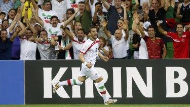 Iranian fans celebrate Ehsan Haji Safi's goal on Sunday.
