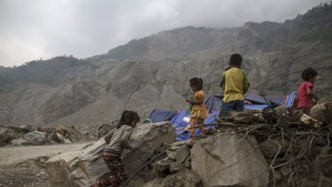 Nepalese children run next to their makeshift shelter near a landslide area after the April 25 earthquake at Jure village in Sindhupalchowk, Nepal. Areas of Nepal remain perilously unstable.