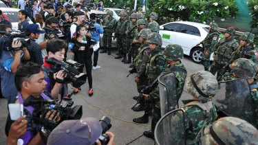 Journalists and the military in a face-off in Bangkok in 2014.