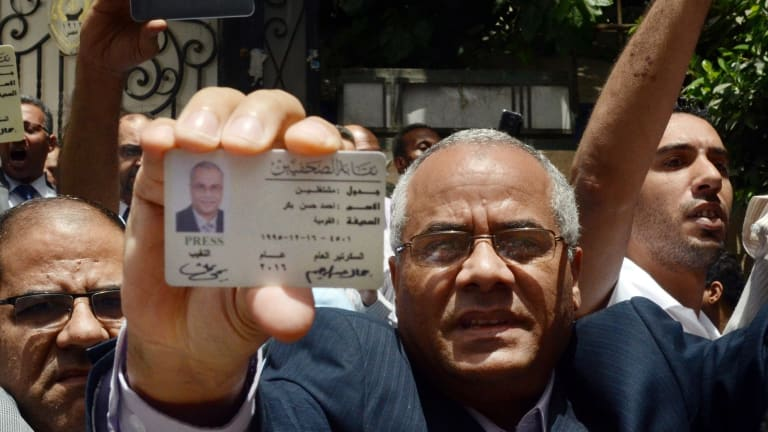 Egyptian-American journalist Ahmed Bakr shows his ID as he and others are blocked from entering a protest near the Press Syndicate in Cairo earlier this month.