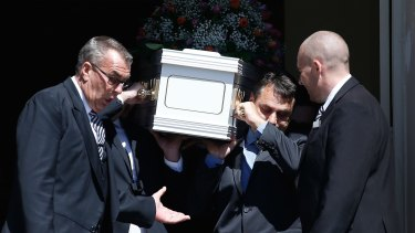 Mourners carry the coffin of the Rozelle blast victims Bianka and Jude O'Brien.